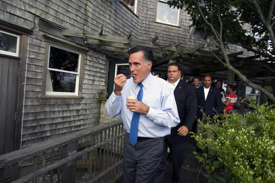Republican presidential candidate, former Massachusetts Gov. Mitt Romney eats ice cream after making a stop at Millie's before a fundraising event on Saturday, Aug. 18, 2012 in Nantucket, Mass.  (AP Photo/Evan Vucci)