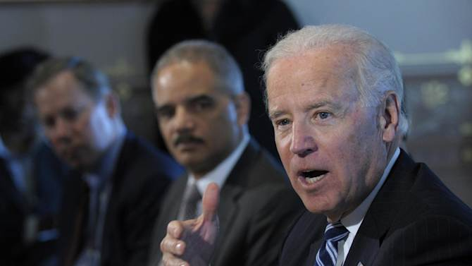 President Joe Biden, accompanied by Attorney General Eric Holder, gestures as he speaks during a meeting with Sportsmen and Women and Wildlife Interest Groups and member of his cabinet, Thursday, Jan. 10, 2013,  in the Eisenhower Executive Office Building on the White House complex in Washington. Biden is holding a series of meetings this week as part of the effort he is leading to develop policy proposals in response to the Newtown, Conn., school shooting (AP Photo/Susan Walsh)