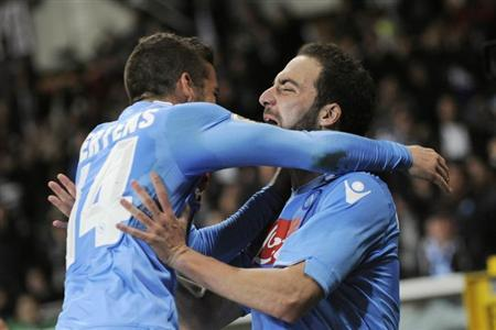 Napoli's Gonzalo Higuain (R) celebrates with his team mate Dries Mertens after scoring against Torino FC during their Italian Serie A soccer match at Olympic Stadium in Turin March 17, 2014. REUTE