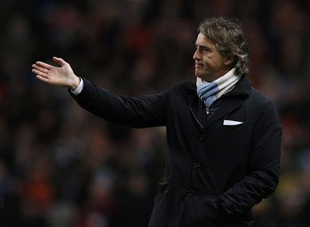 Manchester City's manager Mancini gestures during their English FA Cup quarter-final soccer match against Barnsley in Manchester