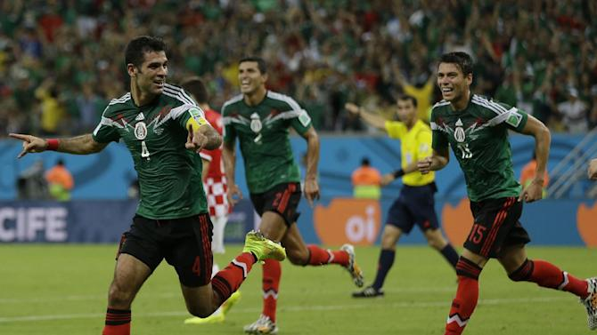 Mexico's Rafael Marquez celebrates after scoring  the first goal of his team during the group A World Cup soccer match between Croatia and Mexico at the Arena Pernambuco in Recife, Brazil, Monday, June 23, 2014. Mexico won 3-1