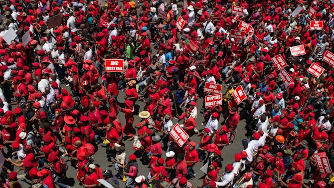 CAPTION CORRECTS PHOTOGRAPHERS NAME - Members of the Economic Freedom Fighters  march to the Constitutional Court in Johannesburg, Tuesday, Feb. 9, 2016. South Africa's highest court on Tuesday heard a case against President Jacob Zuma, who is accused of violating the constitution in a scandal over state spending on his private home. Opposition parties brought the case against Zuma to the Constitutional Court, whose proceedings in a packed, brick-lined chamber were shown on live television. Opposition protesters marched to the courthouse as the judges inside considered whether the president broke the law by failing to follow a 2014 recommendation from the state watchdog agency that he pay back some of the more than $20 million in home upgrades. (AP Photo/Jacques Nelles)