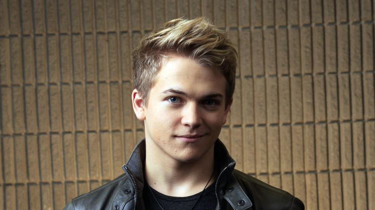 "FILE - This March 8, 2012 file photo shows Hunter Hayes in Nashville, Tenn. The 21-year-old Louisiana native is up for three trophies at the Feb. 10 Grammy Awards in Los Angeles, including all-genre award best new artist. The nominations punctuate a period of great growth for Hayes in the 18 months since he released that album. He scored his first No. 1 with ""Wanted,"" becoming the youngest solo male country performer to top the chart. And he began to play in front of larger crowds on tour with several established stars, including Carrie Underwood. (AP Photo/Mark Humphrey, file)"