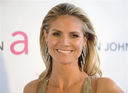 Supermodel Heidi Klum arrives at the 2013 Elton John AIDS Foundation Oscar Party in West Hollywood, California, February 24, 2013. REUTERS/Gus Ruelas