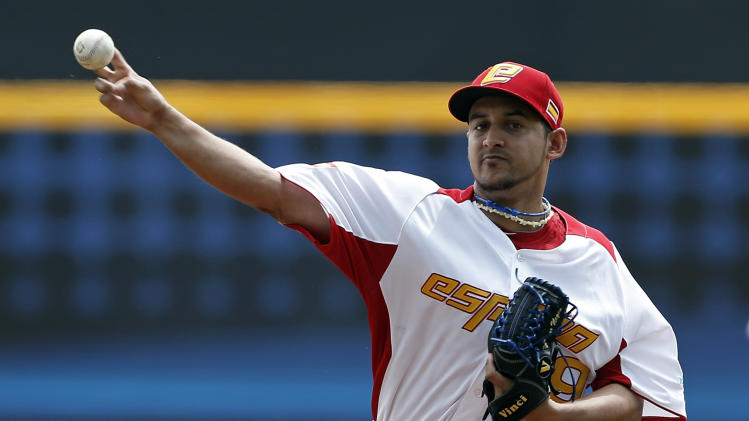 Spain's starting pitcher Yoanner Negrin throws in the first inning against the Dominican Republic during a World Baseball Classic game in San Juan, Puerto Rico, Saturday, March 9, 2013. (AP Photo/Andres Leighton)