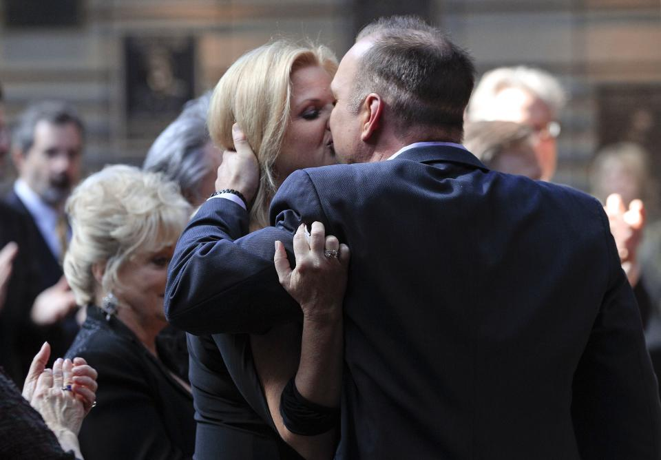 "Garth Brooks kisses his wife, Trisha Yearwood, Tuesday, March 6, 2012, after it was announced that Brooks will be inducted into the Country Music Hall of Fame in Nashville, Tenn. Brooks, Connie Smith, and Hargus ""Pig"" Robbins will become the newest members. (AP Photo/Mark Humphrey)"
