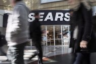 Commuters walk past a Sears store in Toronto on Thursday April 25, 2013. THE CANADIAN PRESS/Chris Young