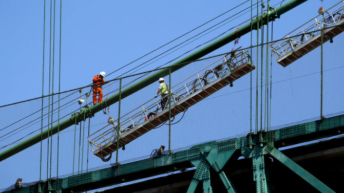 """Construction workers set up a scaffold  atop the Vincent Thomas Bridge in the San Pedro section of Los Angeles on Monday Aug. 20,2012. Tony Scott, director of such Hollywood hits as """"Top Gun,"""" ''Days of Thunder"""" and """"Beverly Hills Cop II,"""" died Sunday Aug. 19, 2012, after jumping from the Los Angeles County bridge, authorities said.  (AP Photo/Nick Ut)"""