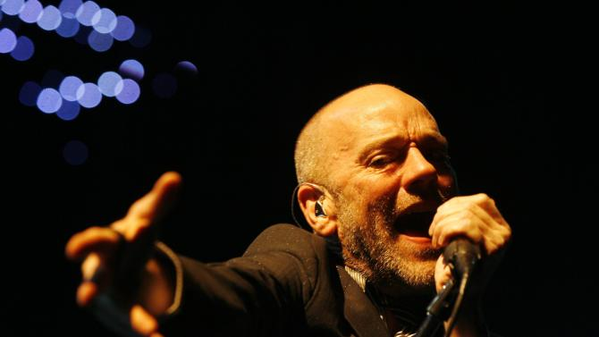 """FILE - In this Sept. 24, 2008 file photo, Michael Stipe, frontman of the rock band R.E.M., performs on stage at the Hallenstadion in Zurich, Switzerland. The band's 1987 single """"It's the End of the World As We Know It (And I Feel Fine)"""" was the most viral track on Spotify for the week of Dec. 17, 2012. (AP Photo/Keystone/Steffen Schmidt)"""
