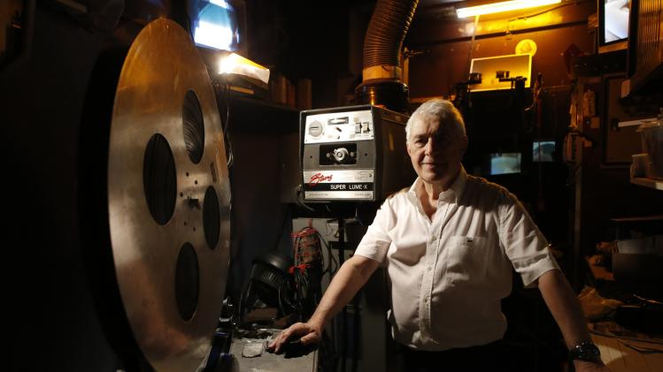 Maurice Laroche, owner of Le Beverley adult cinema, poses inside the projection room at his cinema in Paris