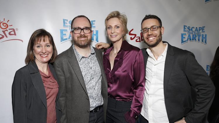 """Producer Catherine Winder, Director Cal Brunker, Jane Lynch and Co-Writer Bob Barlen attend the LA premiere of """"Escape from Planet Earth"""" at the Chinese Theater on Saturday, Feb. 2,2013 in Hollywood. (Photo by Todd Williamson/Invision/AP Images)"""