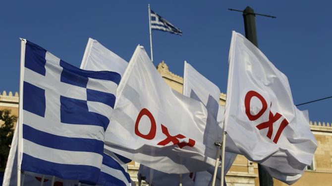 "Flags bearing the word ""No"" fly in front of the parliament building before an anti-austerity rally in Athens"