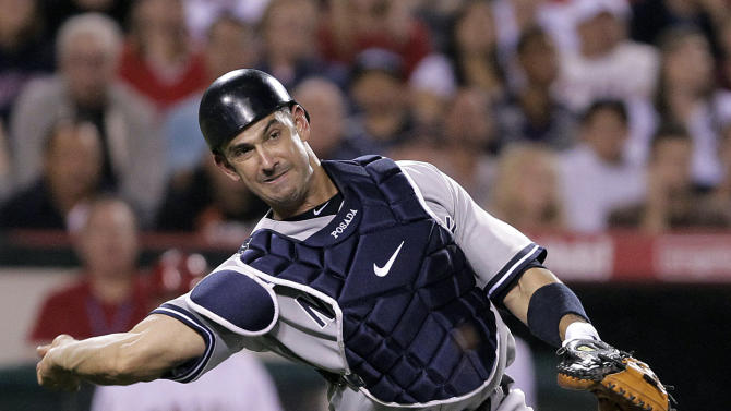New York Yankees catcher Jorge Posada throws to first base after fielding a ball hit by Los Angeles Angels' Erick Aybar in the sixth inning of a baseball game in Anaheim, Calif., Saturday, Sept. 10, 2011. (AP Photo/Jae Hong)