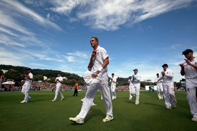 England's Broad is applauded by teammates while walking off the ground during third day second test against New Zealand in Wellington