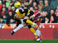 Blackburn Rovers' Ruben Rochina, left, and Stoke City's Rory Delap battle for the ball during the English Premier League soccer match at The Britannia Stadium, Stoke-on-Trent, England, Saturday Nov. 26, 2011. Stoke City won the match 3-1. (AP Photo/PA, Dave Howarth) UNITED KINGDOM OUT NO SALES NO ARCHIVE
