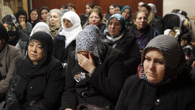 """Women react inside the Kurdish cultural center in Paris, Thursday, Jan. 10, 2013. Three Kurdish women including Sakine Cansiz, one of the founders of a militant group battling Turkish troops since 1984, were """"executed"""" at a Kurdish center in Paris, the interior minister said Thursday. (AP Photo/Christophe Ena)"""