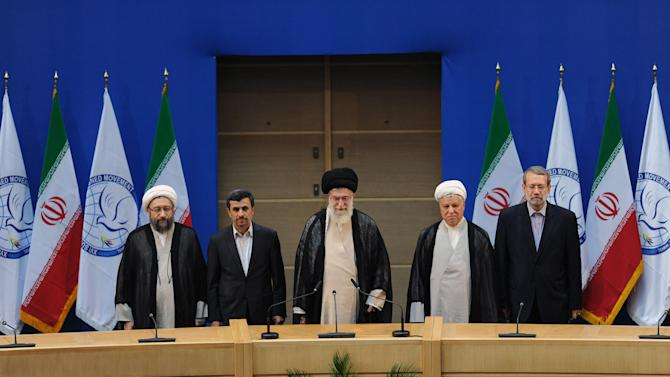 In this photo released by the official website of the Iranian supreme leader's office, supreme leader Ayatollah Ali Khamenei, center, parliament speaker Ali Larijani, right, chief of Expediency Council, Akbar Hashemi Rafsanjani, second right, President Mahmoud Ahmadinejad, second left, and judiciary chief Sadeq Larijani, left, listen to Iran's national anthem, at the opening session of the Nonaligned Movement, NAM, summit, in Tehran, Iran, Thursday, Aug. 30, 2012. (AP Photo/Office of the Supreme Leader)