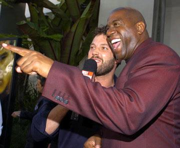 "Ben Affleck and Earvin ""Magic"" Johnson at the Hollywood premiere of Universal Pictures' The Bourne Supremacy"
