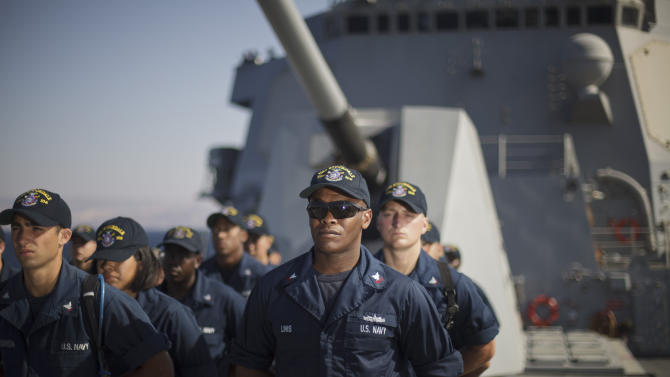 U.S. Navy sailors stand in formation aboard the USS Stockdale before maneuvers with the Jordanian Navy in the Gulf of Aqaba, Jordan as part of Eager Lion, a multinational military exercise, Tuesday, June 18, 2013. Under the watchful eye of stern-faced American advisers, hundreds of U.S.-trained Jordanian soldiers are holding war games that could eventually form the basis of an assault in Syria. There is fear of spillover from the Syrian war in this U.S.-allied kingdom, and the potential for a Jordanian role in securing Syria's chemical stockpiles should Bashar Assad's regime lose control. (AP Photo/Maya Alleruzzo)