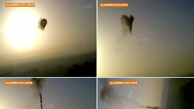 In this combo made from images from amateur video provided by Al-Jazeera, smoke pours from a hot air balloon over Luxor, Egypt, top left, before bursting, top right, and plummeting about 1,000 feet to earth, bottom left and right, on Tuesday, Feb. 26, 2013. Nineteen people were killed in what appeared to be the deadliest hot air ballooning accident on record. A British tourist and the Egyptian pilot, who was badly burned, were the sole survivors. (AP Photo/Al-Jazeera) MANDATORY CREDIT: AL-JAZEERA