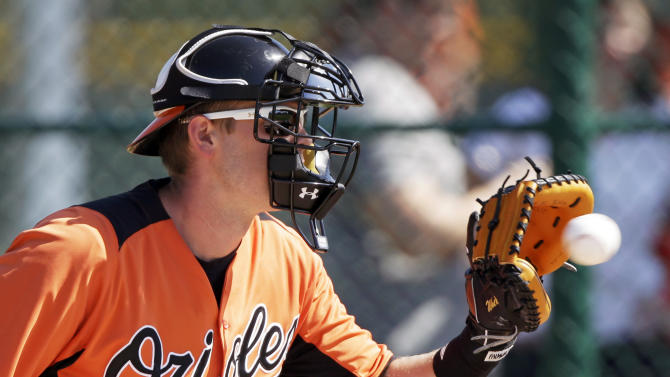 Baltimore Orioles catcher Matt Wieters catches the ball during a drill at a baseball spring training workout Wednesday, Feb. 13, 2013, in Sarasota, Fla. (AP Photo/Charlie Neibergall)