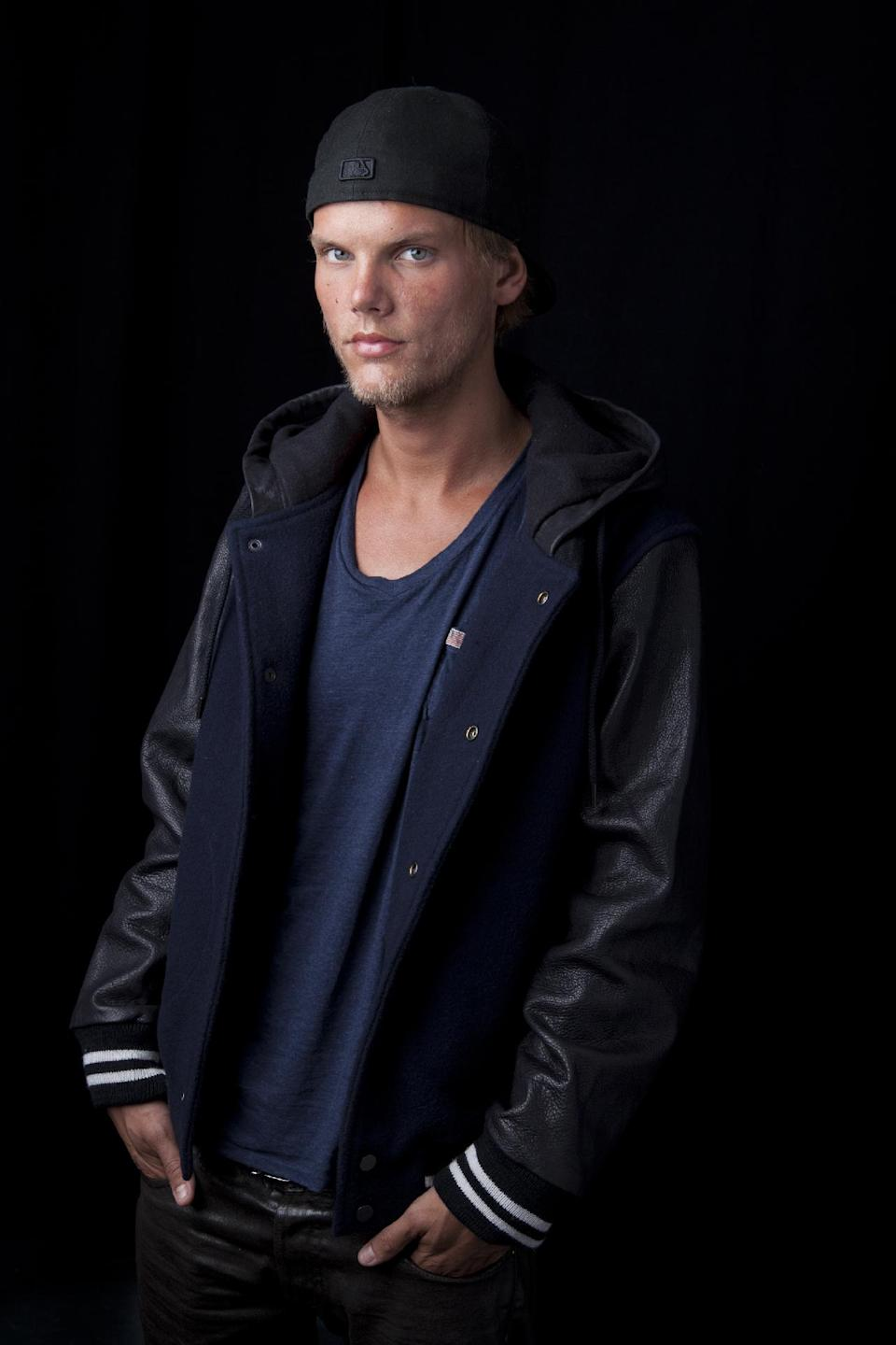 Swedish DJ, remixer and record producer Avicii poses for a portrait, on Friday, August 30, 2013 in New York. (Photo by Amy Sussman/Invision/AP)