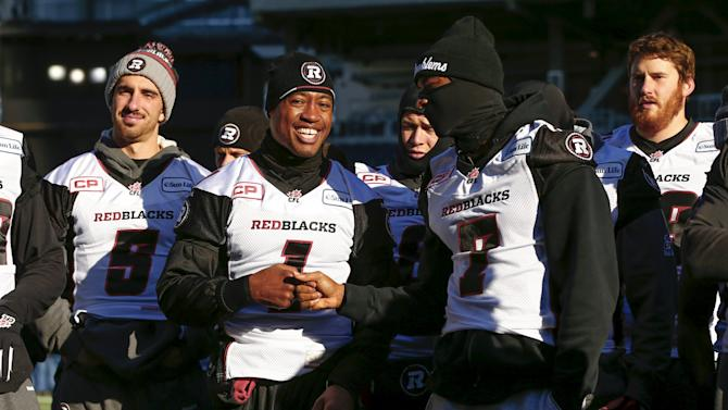Ottawa Redblacks quarterback Burris stands with Price and O'Brien during their team's walkthrough practice ahead of the CFL 103rd Grey Cup championship football game in Winnipeg