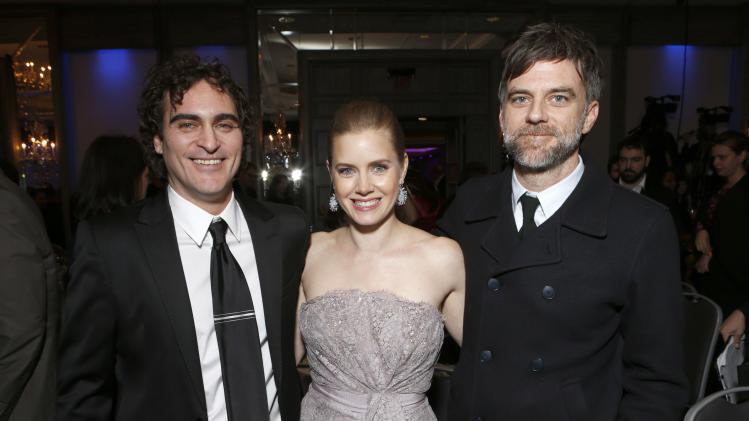 Joaquin Phoenix, Amy Adams and  Paul Thomas Anderson attend the LA Film Critics Association Awards at the InterContinental Hotel on Saturday, Jan. 12, 2013, in Los Angeles. (Photo by Todd Williamson/Invision/AP)