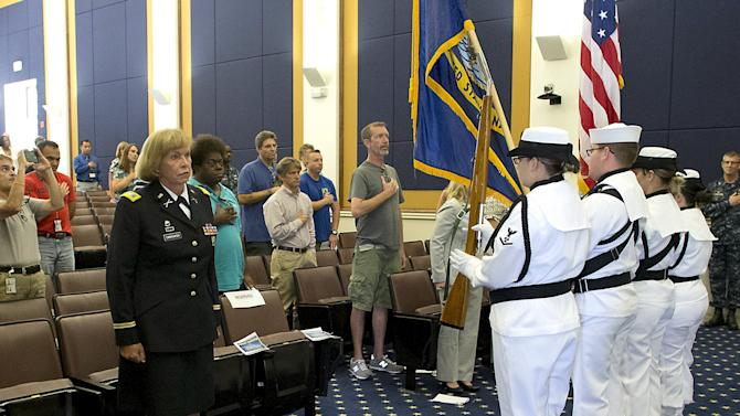 Retired Army Colonel Swokowski stands at attention as the U.S. national anthem is sung during the U.S. Navy's Fleet Readiness Center Southwest's first LGBT pride event in San Diego