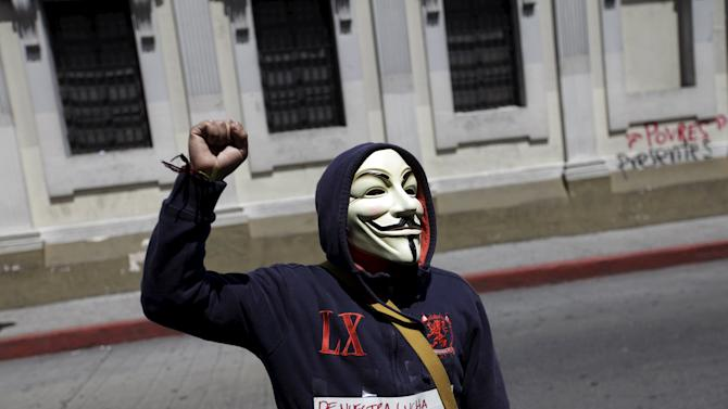 A protester gestures outside the Guatemalan Congress during a meeting of an investigative commission in Guatemala City