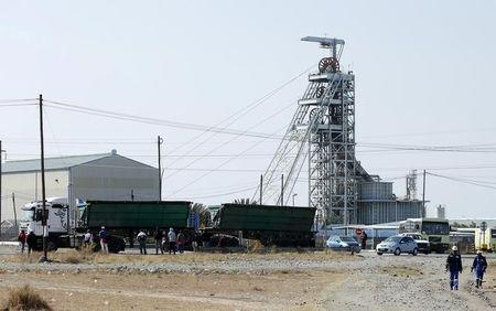 Workers leave Lonmin's Karee mine at the end of their shift, outside Rustenburg, northwest of Johannesburg