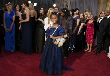 Quvenzhane Wallis, best actress nominee for her role in &quot;Beasts of the Southern Wild&quot;, wearing Armani Junior and carrying her dog purse, arrives at the 85th Academy Awards in Hollywood, California February 24, 2013. REUTERS/Lucy Nicholson