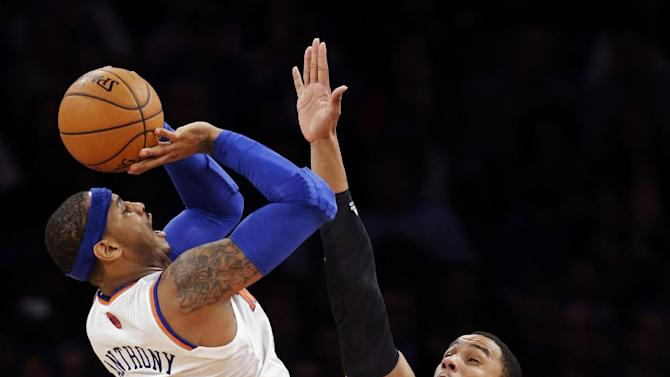New York Knicks forward Carmelo Anthony (7) shoots over Boston Celtics forward Jared Sullinger (7) in the second half of their NBA basketball game at Madison Square Garden in New York, Monday, Jan. 7, 2013. The Celtics won 102-96. (AP Photo/Kathy Willens)