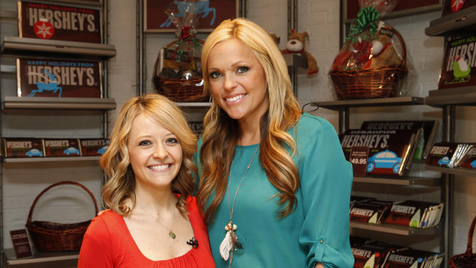 Celebrity chef Kelsey Nixon and former Olympic softball player Jennie Finch are seen at the Hershey's Chocolate World Attraction Times Square during the Hershey's Moderation Nation event in New York City on November 15, 2012. (Amy Sussman/AP Images for The Hershey Company)