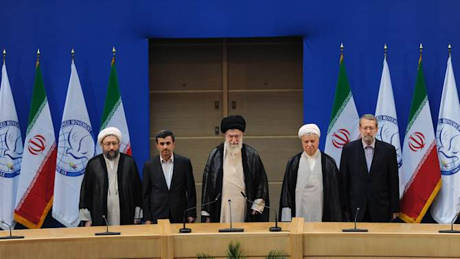 In this photo released by the official website of the Iranian supreme leader's office, supreme leader Ayatollah Ali Khamenei, center, parliament speaker Ali Larijani, right, chief of Expediency Council, Akbar Hashemi Rafsanjani, second right, President Mahmoud Ahmadinejad, second left, and judiciary chief Sadeq Larijani, left, listen to Iran's national anthem, at the start of the Nonaligned Movement, NAM, summit, in Tehran, Iran, on Thursday, Aug. 30, 2012. (AP Photo/Office of the Supreme Leader)