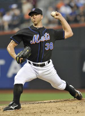 New York Mets pitcher Chris Capuano throws to the Florida Marlins in the first inning of a baseball game Monday, July 18, 2011, in New York. (AP Photo/Kathy Kmonicek)