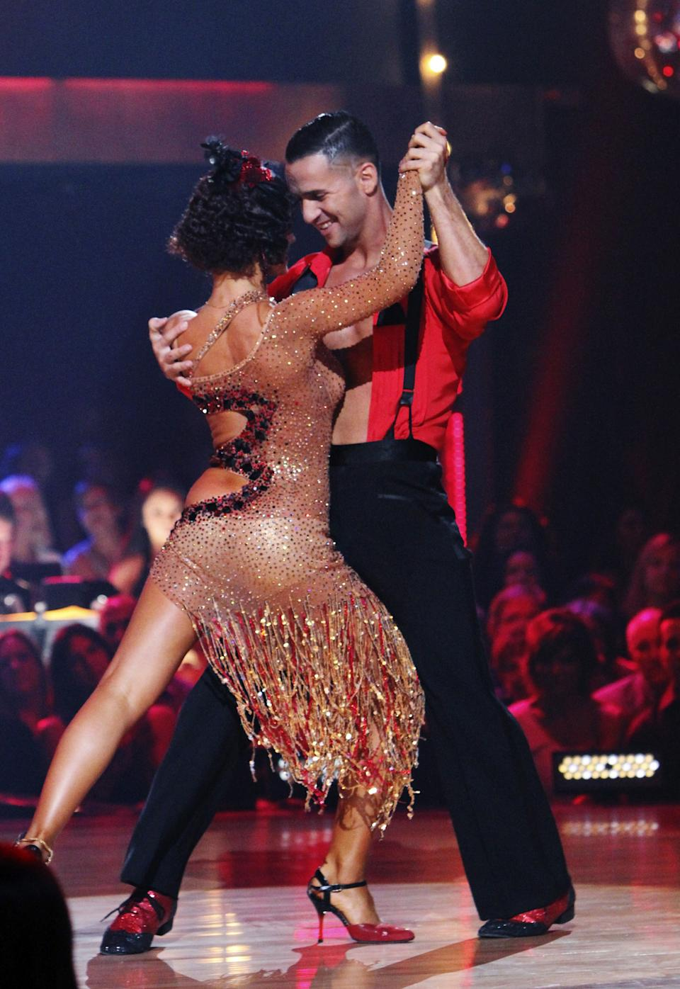 "In this publicity image released by ABC, Mike ""The Situation"" Sorrentino, right, and his partner Karina Smirnoff perform on the celebrity dance competition series, ""Dancing with the Stars,"" Monday, Oct. 11, 2010 in Los Angeles. (AP Photo/ABC, Adam Larkey)"