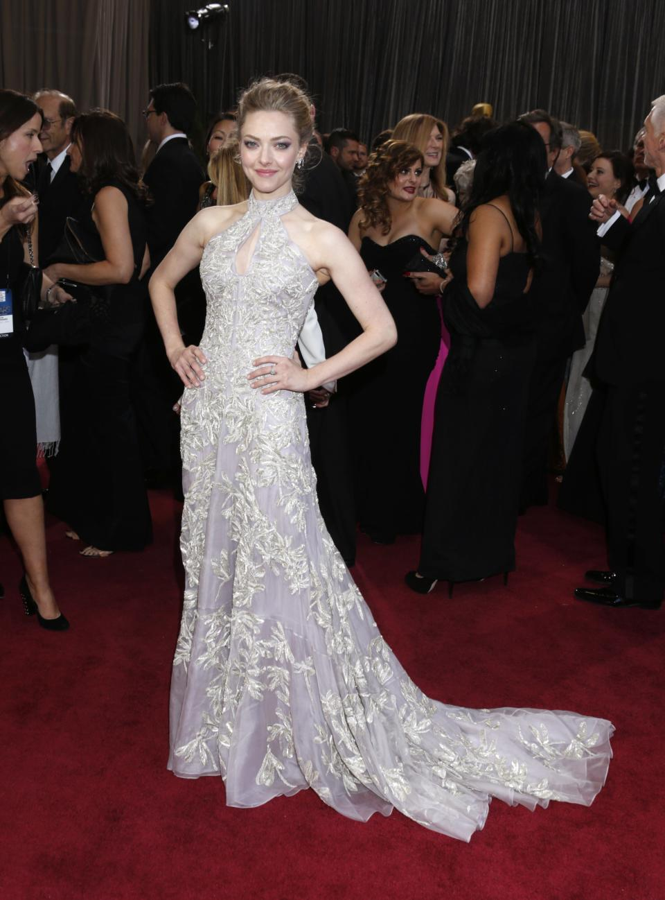 Actress Amanda Seyfried arrives at the Oscars at the Dolby Theatre on Sunday Feb. 24, 2013, in Los Angeles. (Photo by Todd Williamson/Invision/AP)