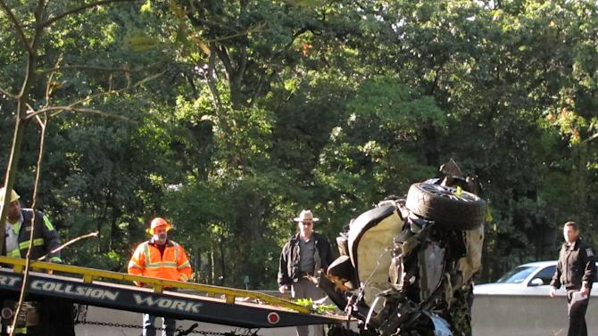 Wreckage from a one-car fatal crash is loaded onto a flatbed truck on the Southern State Parkway in West Hempstead, N.Y., Monday, Oct. 8, 2012. New York State Police say four people were killed in the early Monday accident on Long Island. The westbound lanes of the parkway were closed between exits 17-19. Police say a fifth person was taken to a hospital. (AP Photo/Frank Eltman)