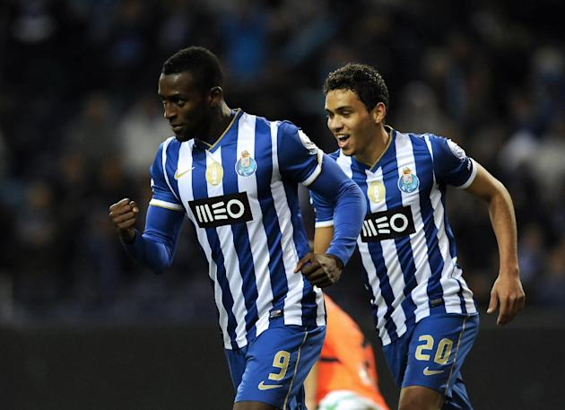 FC Porto's Jackson Martinez, from Colombia, celebrates after scoring the opening goal with Carlos Eduardo, right, from Brazil against Vitoria Setubal in a Portuguese League soccer match at the Dra