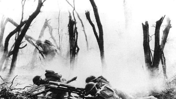 FILE - American infantrymen fire a 37mm gun at a German position in France during World War I. (AP Photo, File)