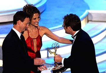 "Gary Sinise and Melina Kanakaredes presenting James Spader of ""The Practice"" Outstanding Lead Actor in a Drama Series Emmy Awards - 9/19/2004"