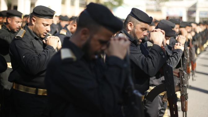Members of Palestinian security forces loyal to Hamas turn their weapons during a parade  in Gaza City