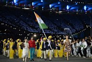 "India's flagbearer Sushil Kumar leads his country's delegation during the opening ceremony of the London 2012 Olympic Games on July 27. To the left of him, in red, is a gatecrasher who has sparked an uproar from India, who claimed the unidentified woman ""embarrassed us in front of the world"". Olympics organisers Sunday labelled her an ""over-excited"" cast member and said she was no security risk"