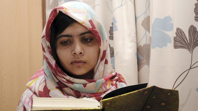 FILE - In this undated file photo provided by Queen Elizabeth Hospital in Birmingham, England, Malala Yousufzai, the 15-year-old girl who was shot at close range in the head by a Taliban gunman in Pakistan, reads a book as she continues her recovery at the hospital. The Pakistani schoolgirl who was shot in the head by the Taliban is in stable condition after undergoing two successful operations to reconstruct her skull and restore her hearing, the British hospital treating her said Sunday.  (AP Photo/Queen Elizabeth Hospital, File)