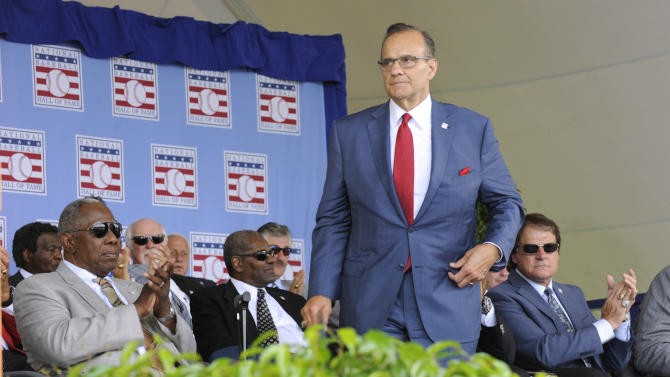 National Baseball Hall of Fame inductee Joe Torre steps up to the podium during an induction ceremony at the Clark Sports Center on Sunday, July 27, 2014, in Cooperstown, N.Y. (AP Photo/Tim Roske)