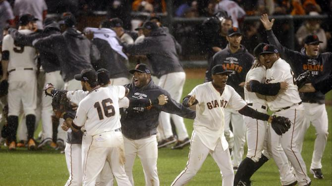 The San Francisco Giants celebrate after the final out in Game 7 of baseball's National League championship series against the St. Louis Cardinals Monday, Oct. 22, 2012, in San Francisco. The Giants won 9-0 to win the series. (AP Photo/Mark Humphrey)