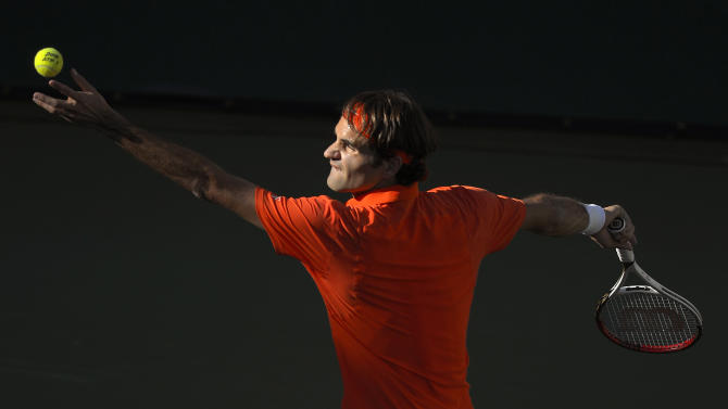 Roger Federer, of Switzerland, serves to Stanislas Wawrinka, of Switzerland, during their match at the BNP Paribas Open tennis tournament, Wednesday, March 13, 2013, in Indian Wells, Calif. (AP Photo/Mark J. Terrill)