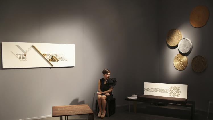 A woman views exhibits at Design Days Dubai exhibition in Dubai
