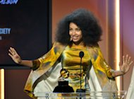 Esperanza Spalding accepts the jazz vocal album for &quot;Radio Music Society&quot; at the 55th annual Grammy Awards on Sunday, Feb. 10, 2013, in Los Angeles. (Photo by John Shearer/Invision/AP)